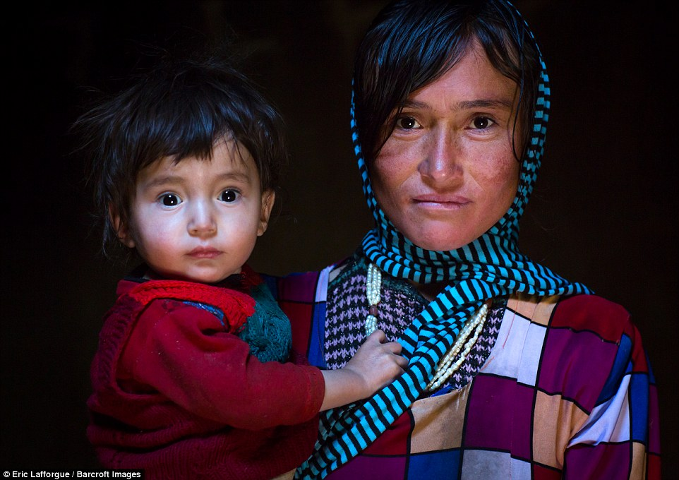 Portrait of an Afghan mother with her son. In a bid to encourage tourism to the region, the women have opened a souvenir shop with embroideries and socks for sale