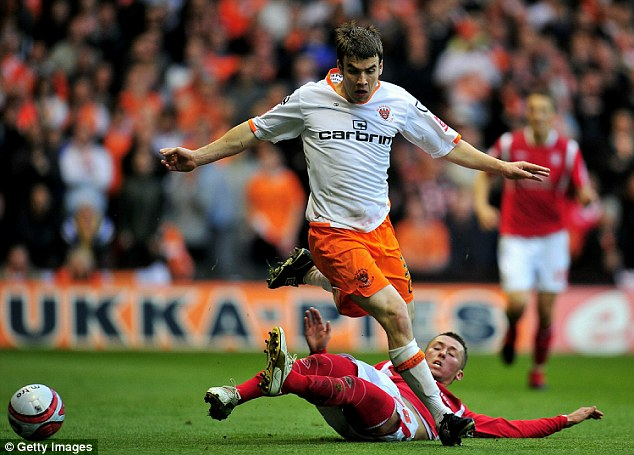 The full back spent time on loan with Blackpool, then playing in the Championship, in 2010