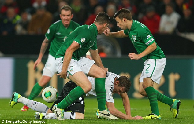 The right back is pictured playing for Ireland against Germany in a 2014 World Cup qualifier