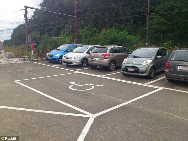 A disabled parking space that would block two parked cars from moving out has been painted in a car park