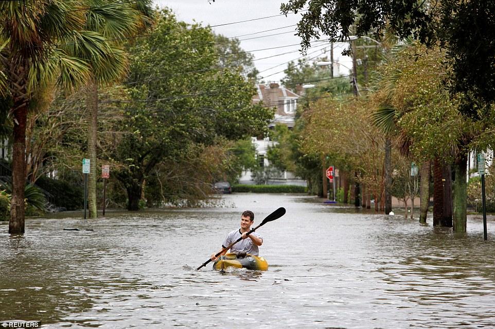 A resident kayaks in flood waters on Rutledge Avenue after Hurricane Matthew hit Charleston, South Carolina
