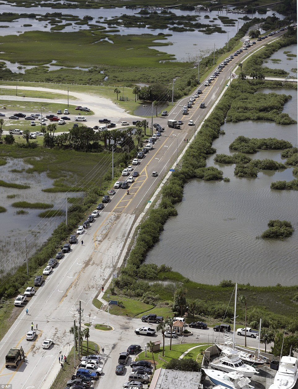 In this aerial photo, residents of St. Augustine wait along side the road to get clearance to return to their homes on Saturday
