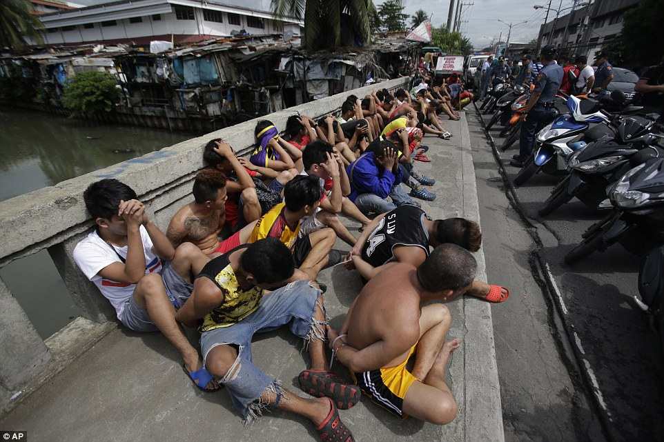 Filipinos cuffed and rounded up in Manila during the drug crackdown  ordered by the president