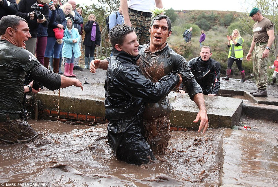 Chilling out: Henry was lifted out of the notorious 'sheep dip' by a friend after he dunked himself and swam through
