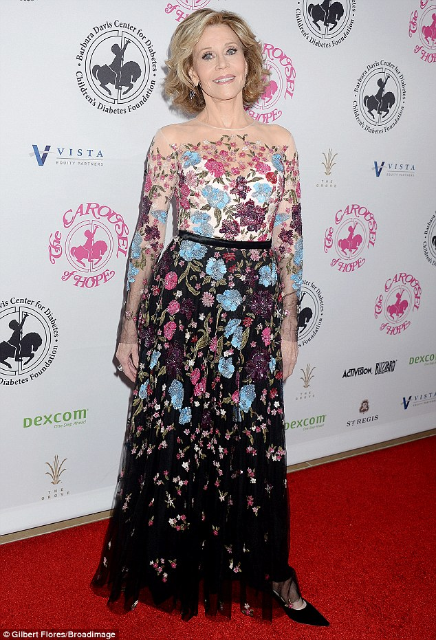 Beaming: Jane Fonda, 78, chose a colorful floral gown with blue, pink, white and black tones