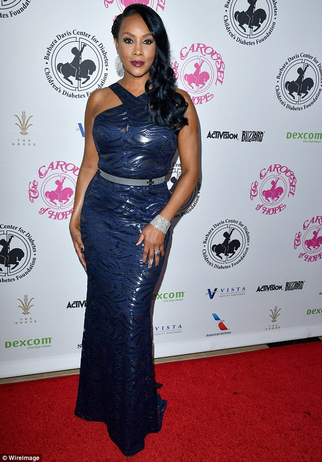 Blue goddess: Vivica A. Fox, 52, smoldered in a navy frock, adding red lipstick and a diamond encrusted bracelet and rings