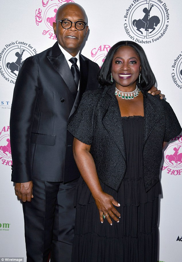 Coordinating couple: Samuel L. Jackson looked handsome in a black suit with a white button-up; he arrived with his wife LaTanya Richardson
