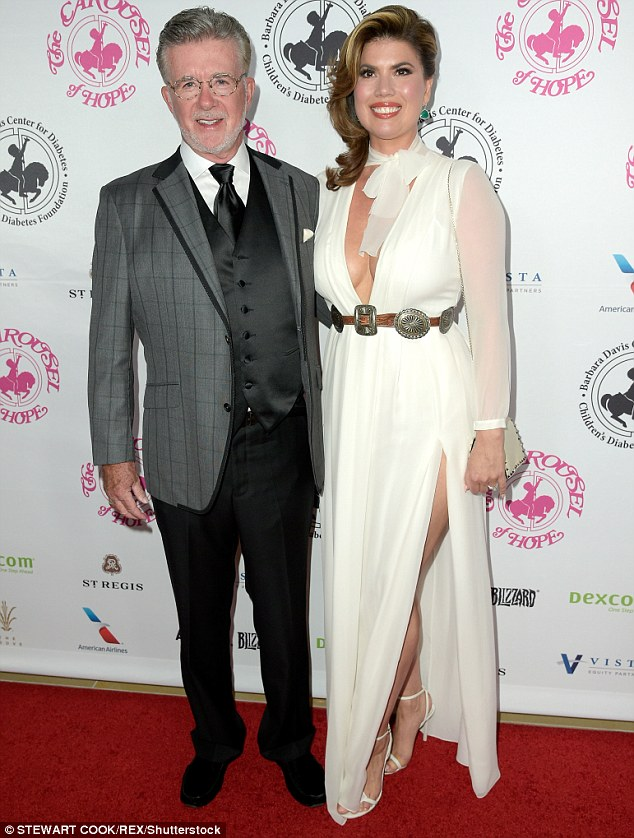 Time for fun: Alan Thicke decided to go for a grey, black and white suit and tie look as he posed on the carpet with wife Tanya Callau