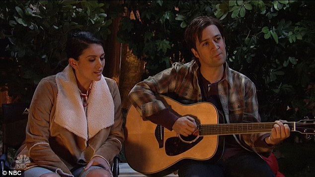 Camp: In his first sketch of the night Lin-Manuel grabbed a guitar and sang around a camp fire with friends, who then wanted to sing an out of tune version of 'Footloose.'