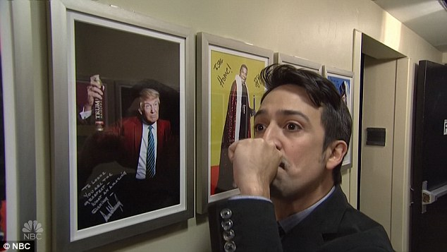 Say how you really feel: He stopped by a signed picture of Donald Trump, whom he described as 'this piece of sh…' before he put his hand over his mouth as the audience roared its approval