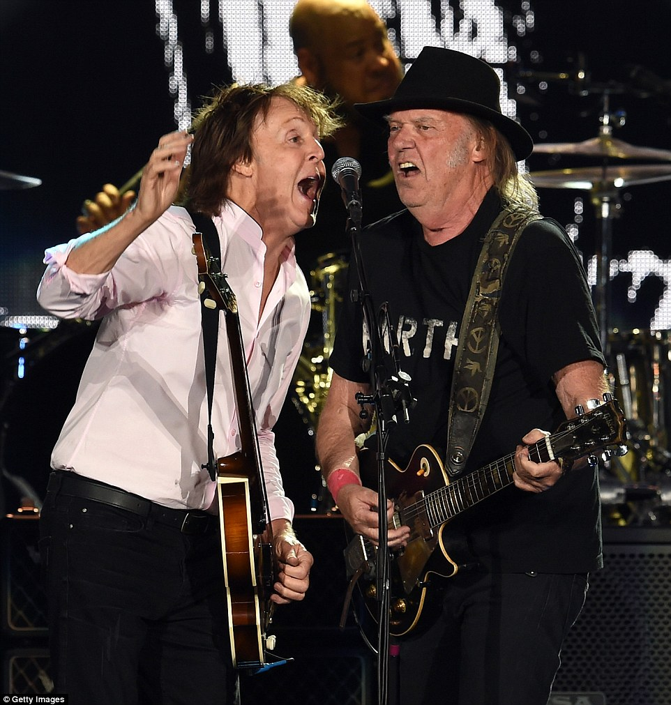 Rocking out: Paul McCartney and Neil Young both sang into the same mic during their jam