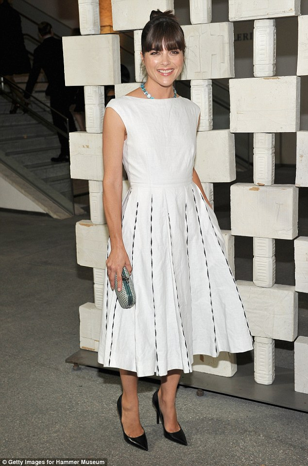Flawless! Selma Blair, 44, looked stunning in a feminine white A-line dress