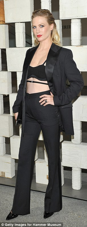 Beauty in black! Mad Men star January Jones, 38, wore a two-piece suit complete with blazer and matching trousers