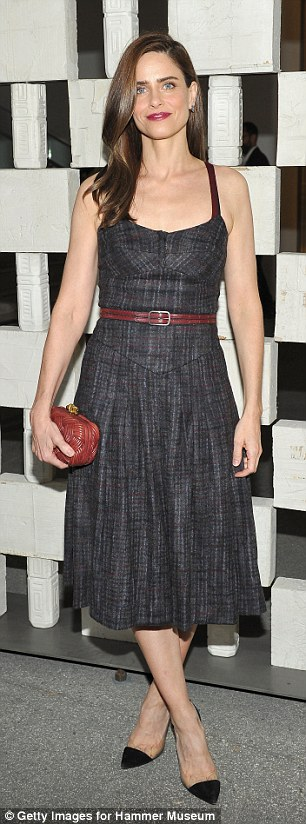 Slender star: Actress Amanda Peet, 44, showed off her slim waistline in a black denim dress with thin red leather belt