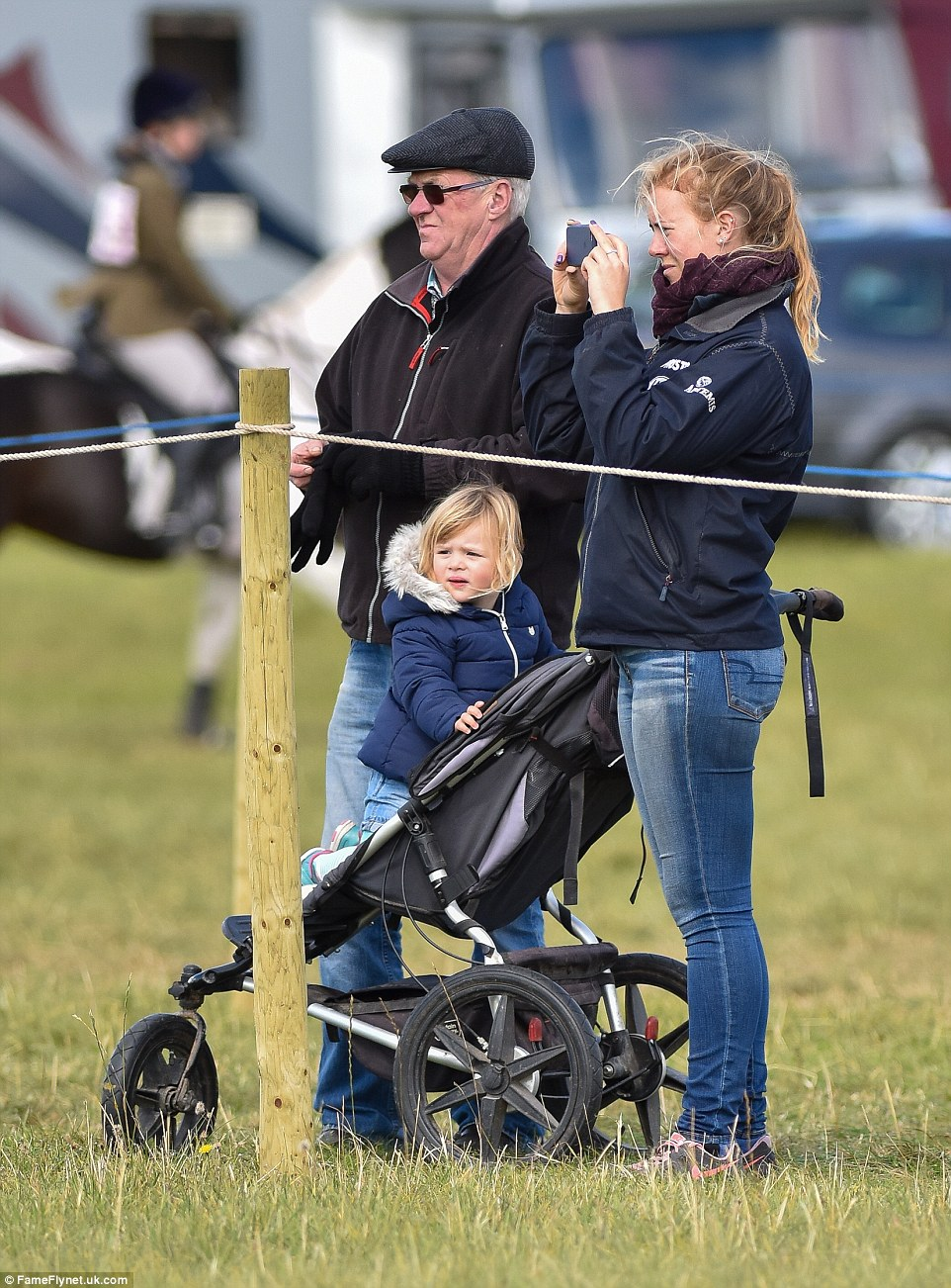 Still in her pushchair, Mia's attention is caught by the goings on at the horse trials, which is one of the fixtures on the British eventing calendar