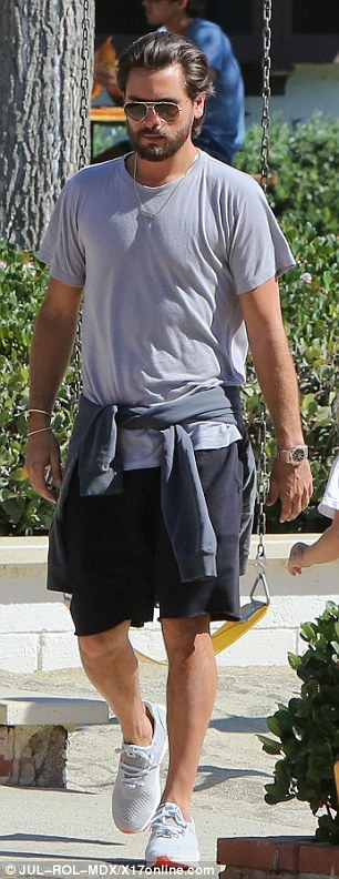 Keeping it casual! Disick donned black shorts, a grey top, trainers, and a sweatshirt wrapped around his waist