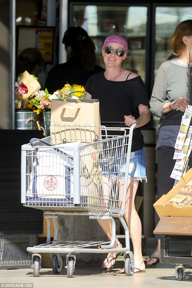Not stopping me: Cancer-battling Shannen Doherty flashed a bright smile as she stocks up on fresh fruit and veggies for her fight