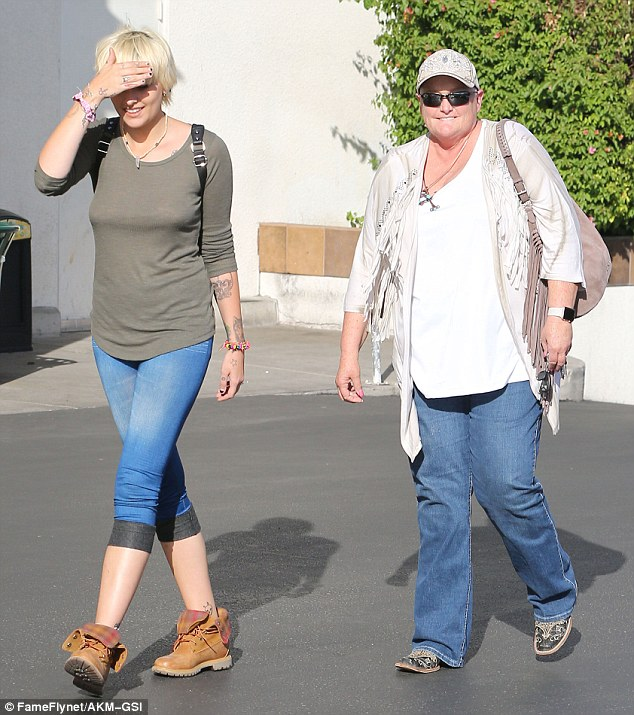 Happy family: On Friday Debbie Row was still able to muster a smile when her daughter Paris Jackson met up with her for a spot of lunch