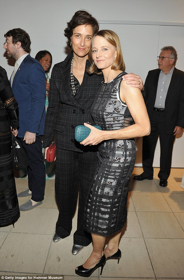 Date night! Jodie Foster and her wife Alexandra Hedison cosied up together for a snap at the Hammer Museum's 14th Annual Gala In The Garden in Los Angeles on Saturday