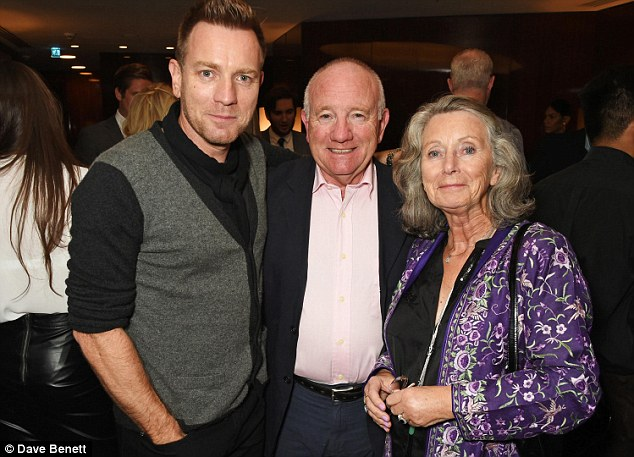 Family affair: Ewan pictured with his parents James McGregor and Carol McGregor