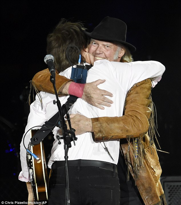 BFFs: Paul and Neil shared a big hug at the end of their performance