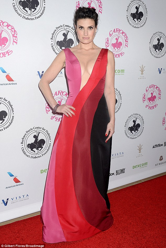 Seeing red: On Saturday Idina Menzel walked the carpet at the Carousel of Hope Ball in Los Angeles