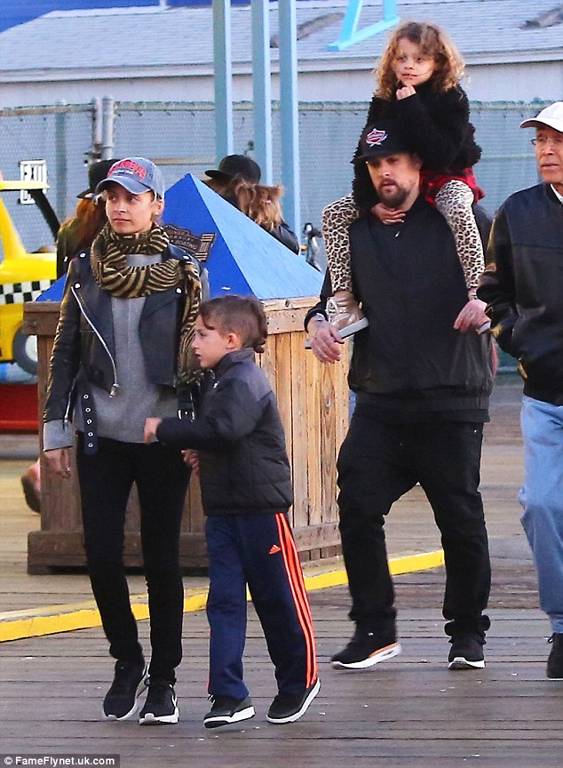 One big happy family: Nicole was snapped with hubby Joel Madden, and their kids Sparrow and Harlow, at the pier in Santa Monica, California in May