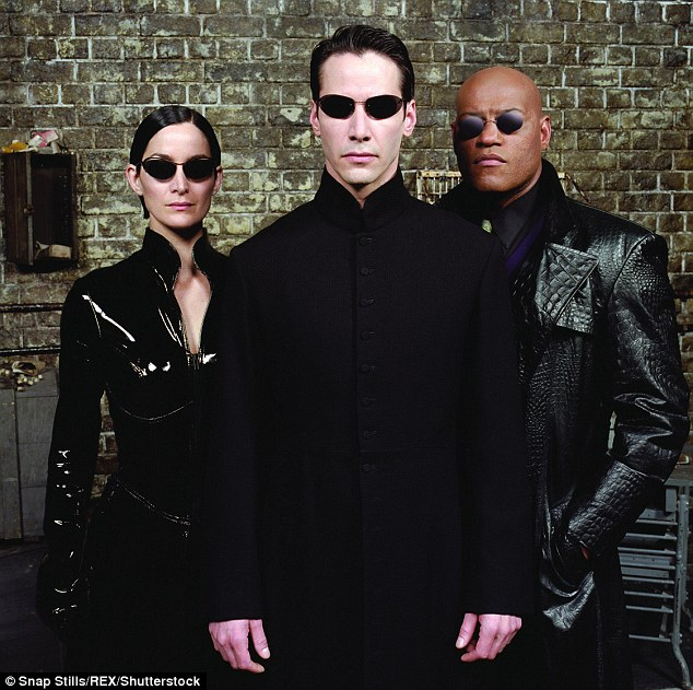 The way we were: Reeves (centre), Fishburne (right) starred with Carrie-Anne Moss in The Matrix, The Matrix Reloaded (pictured) and The Matrix Revolutions