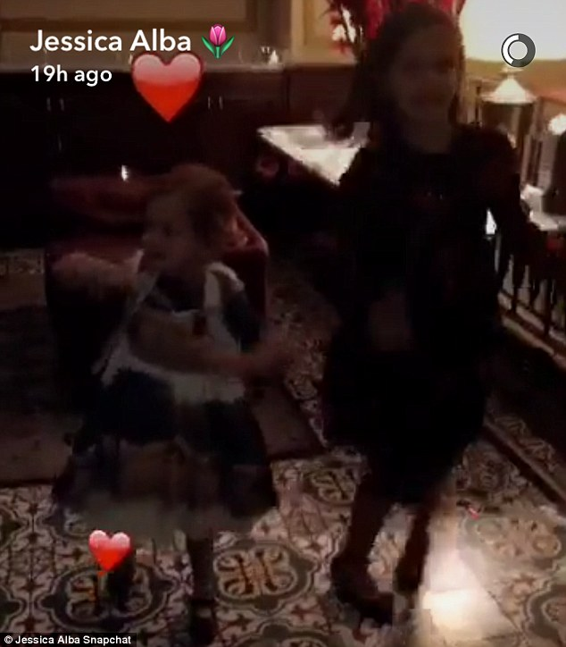 Having a blast: Jessica Alba Snapchatted her daughters Honor Marie, eight, and Haven Garner, five, dancing on Friday night