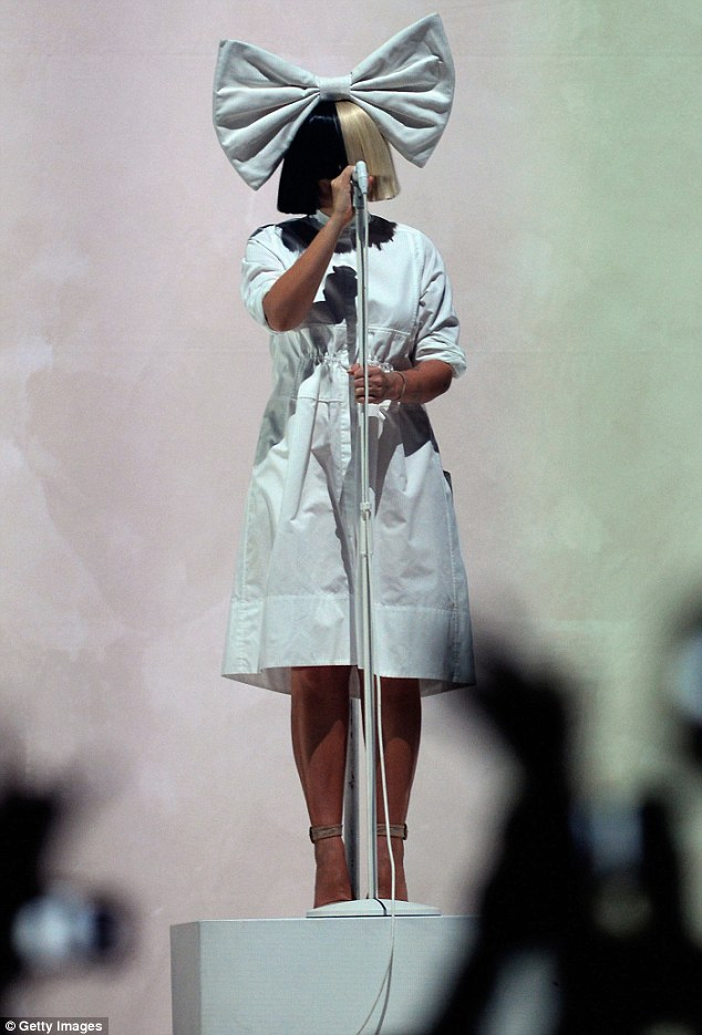 Fan favourite: Wearing a gigantic white bow on her head, Sia paired the large accessory with a smock-like white dress and beige high heels