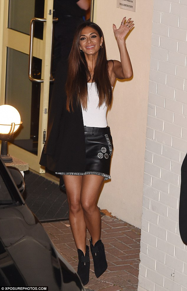 Legs for days: Nicole Scherzinger, 38, emerged from ITV studios following the first live X Factor show looking great in figure-hugging white top and leather miniskirt