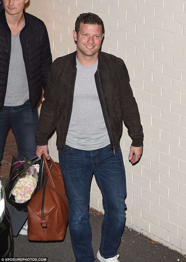 Chirpy: Dermot O'Leary was his usual cheery self as he left in a casual ensemble carrying a holdall and a bouquet of flowers