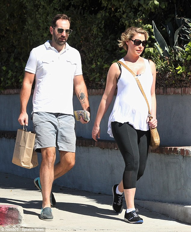Easy look: Katherine was comfortable in a white, sleeveless shirt paired with a set of leggings and trainers