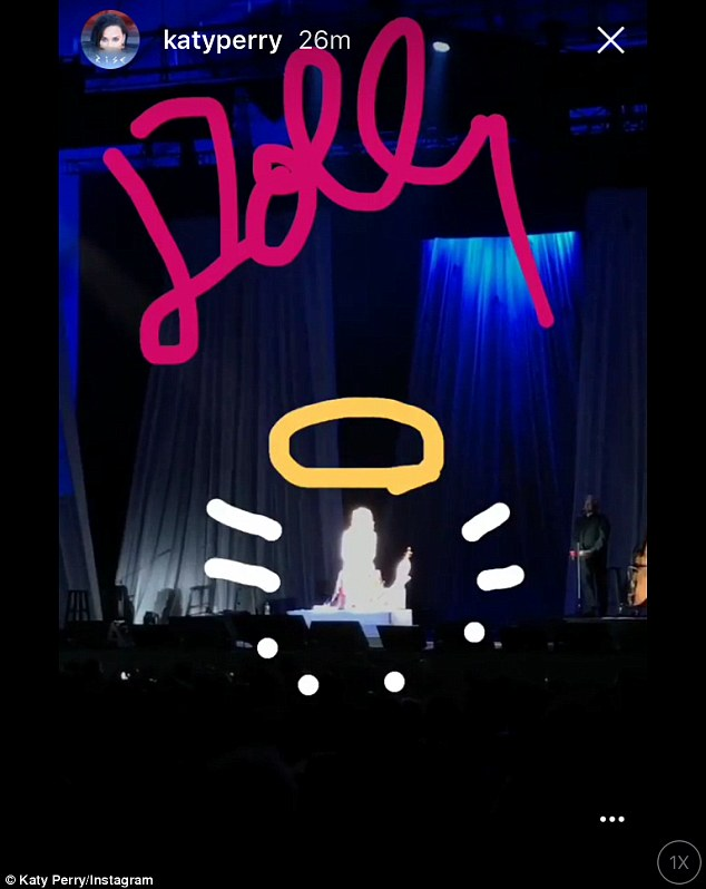 Halo: Katy was so taken with Dolly's performance that she painted an angelic halo over her shining presence