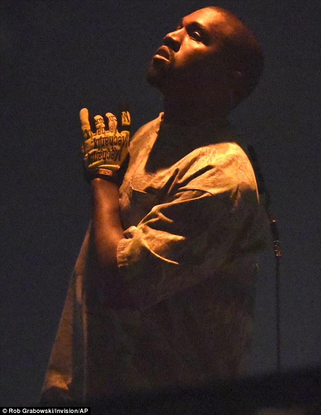Back to it: Kanye West got back to business and returned to the stage for the first time on Friday night since the terrifying robbery
