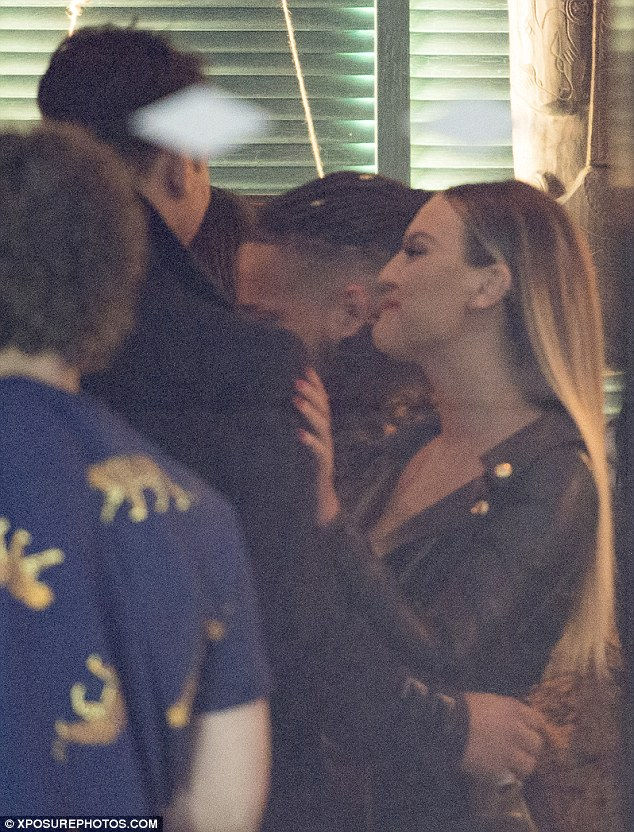 Loved-up: The blonde singer, 23, and her 26-year-old rumoured flame looked besotted with each other at the bash in central London - chatting and giggling together all night