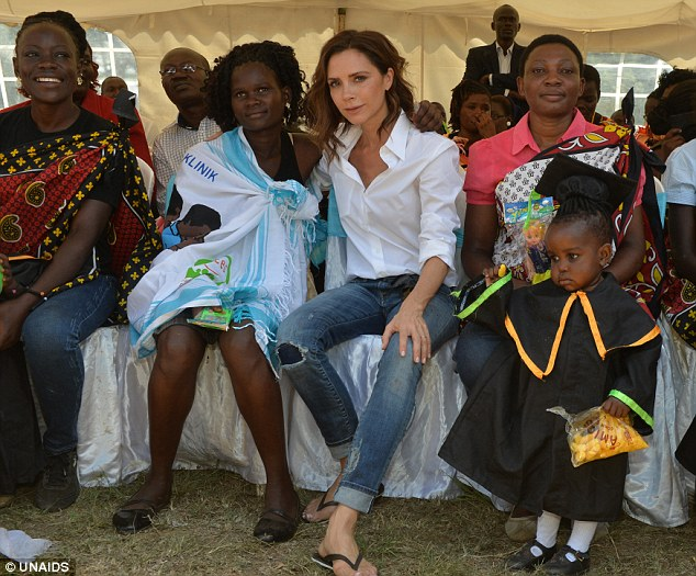 Mercy mission: Victoria  Beckham poses with Kenyan locals for Born Free Africa and UNAIDS
