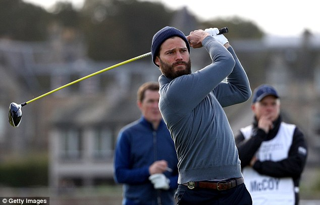 Good hit: The Fifty Shades Of Grey actor looked focused as he drove off the second tee watched carefully by retired champion jockey AP McCoy, 42