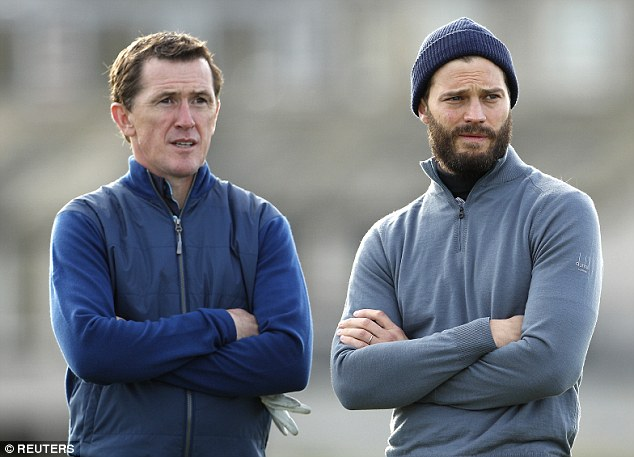 Eyes on the prize: AP and Jamie mirrored each other as they stood with their arms folded