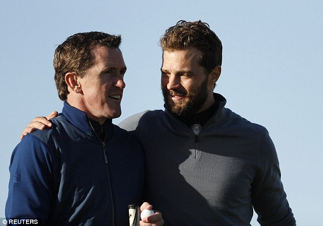Admiration: Jamie looked to have lots of respect for McCoy as he placed his hand on the retired sportsman's shoulder