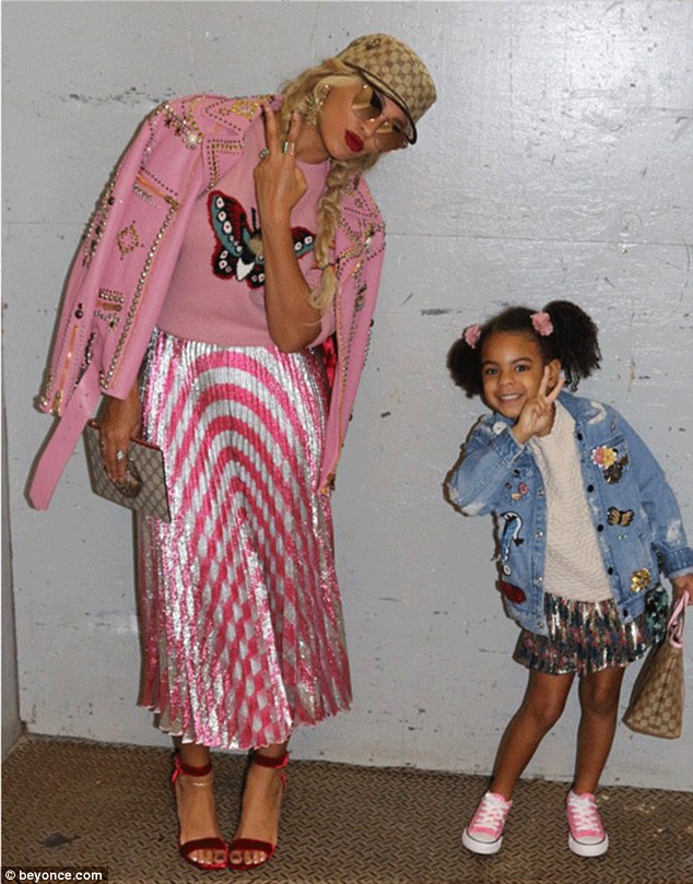 Cute: Beyonce looked perfectly in tune with Blue Ivy, four, on Friday, as they posed for pictures together