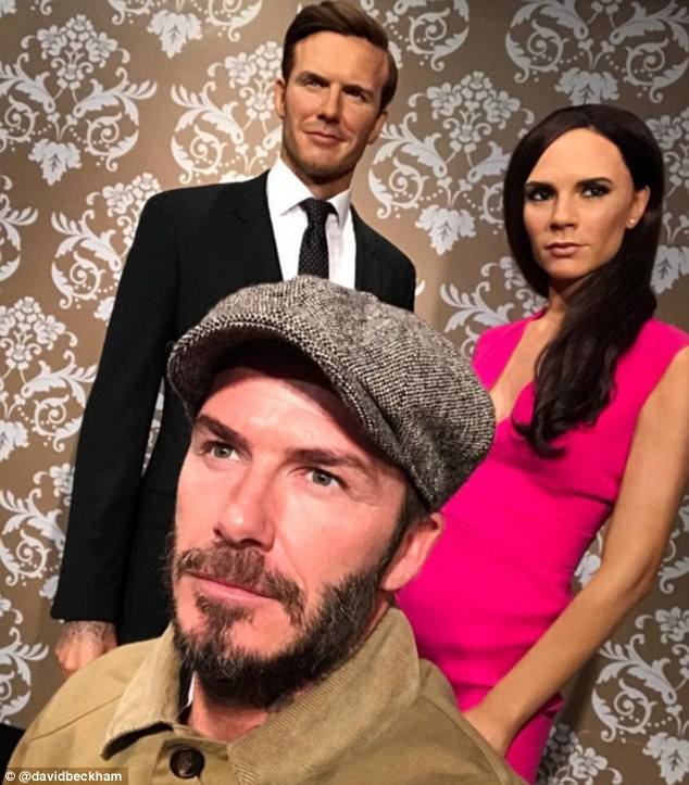 Eerily similar: David Beckham,41, shared a cheeky selfie of his iconic waxwork figure with wife Victoria Beckham at London's Madame Tussauds on Saturday