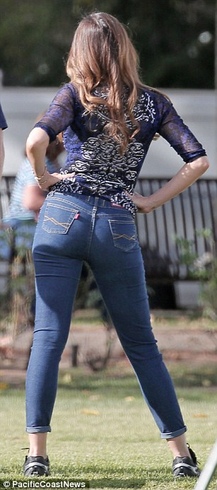 Ready to play! Sofia donned a relaxed outfit for the sporting event, including a blue lace top with sheer half sleeves and some immensely flattering jeans which showed off her taut curves and pert derriere