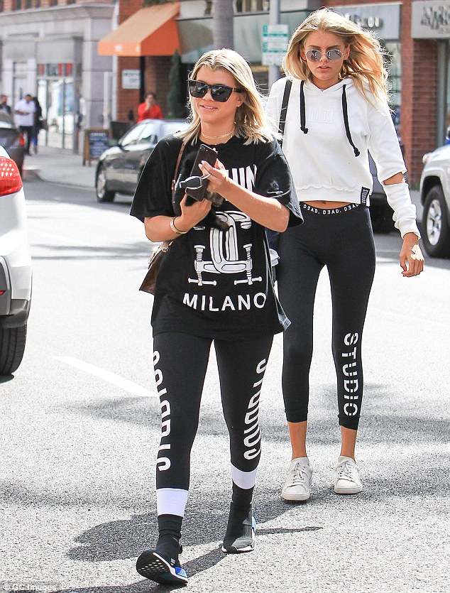 Athletic attire: The teen was dressed comfortably in a Moschino shirt, paired with matching coloured leggings and trainers