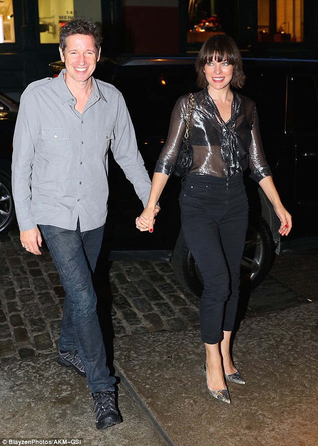 A relaxing night out! The director grinned as he enjoyed some quality time with his other half
