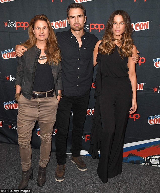 Strike a pose: The 43-year-old actress arrived at New York Comic Con in the tailored one-piece, which cinched at her waist; pictured with director Anna Foerster and Theo James