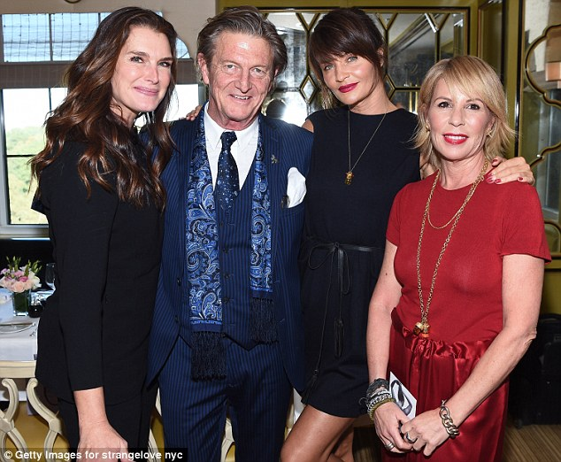 Coordinating ensemble: The mother-of-two paired a long-sleeve top with a pair of matching trousers. She, Helena and Elizabeth are pictured with Nick Graham