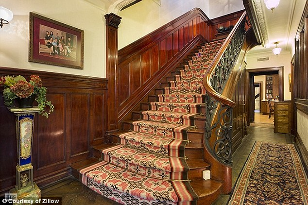 The property boasts a sweeping staircase and original period features