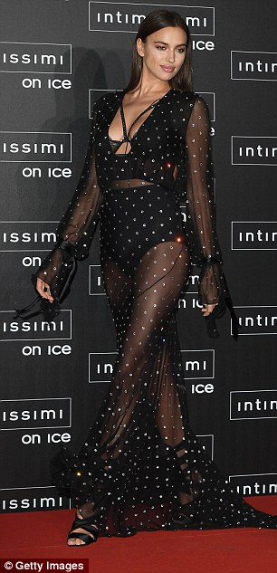 Legs for days: The elegant beauty's flowing gown showed off her endless limbs and a hint of her toned tum