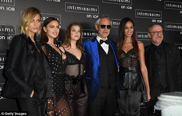 Man of the hour: The beauties also posed beside operatic legend Andrea Bocelli, who performed at the star-studded bash